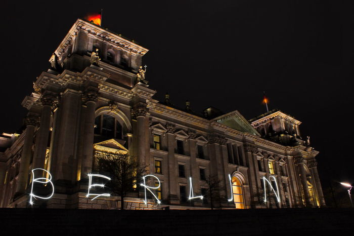 Architecture Berlin Built Structure City Darkness And Light Europe Façade Germany History Holidays Illuminated Light Low Angle View Night No People Outdoors Regierungsviertel Reichstag Sightseeing Travel Destinations Traveling Writing With Light The Architect - 2017 EyeEm Awards