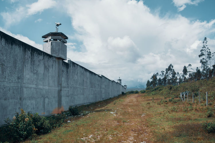 On our exploration tour we stumbled over this prison. It's located in the middle of nowhere next to the canyon. Architecture Built Structure Nature Plant No People Outdoors Prison South America Latin America Cloud - Sky Travel Destinations Wall Security Concrete Sky Building Exterior Building Grass Remote Safe Safety Non-urban Scene Jail Plant Tower