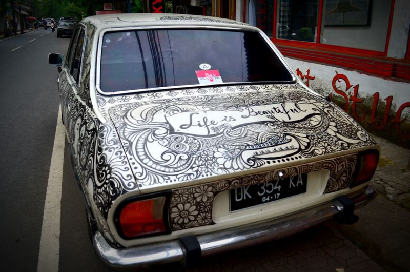 A decorated vintage car in Ubud, Bali, Indonesia Decoration Decorated Car Ubud Bali INDONESIA