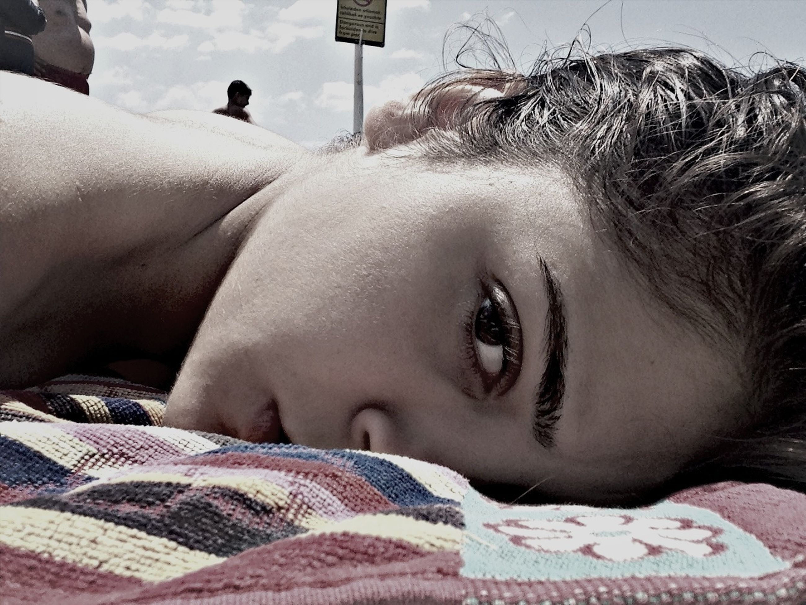 lifestyles, person, headshot, young adult, leisure activity, relaxation, young women, portrait, close-up, looking at camera, lying down, head and shoulders, resting, front view, childhood, human face, day