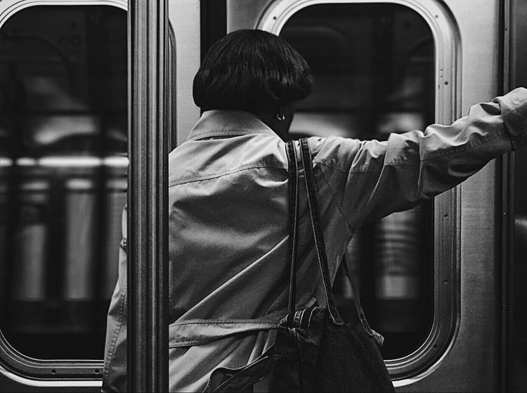 Be. Ready. I'll always admire how strong women are in this city. The grueling schedule for some is almost unbearable-yet they still have to stand at the end of the day because there's no seats left on the train. If I had a seat I'd give you mine. Newyorkcity Ftrain Queens Blackandwhite Subway GhostInNYC