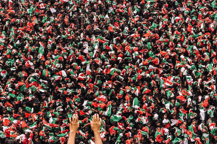 Close-Up Of Crowd Holding Mexican Flags