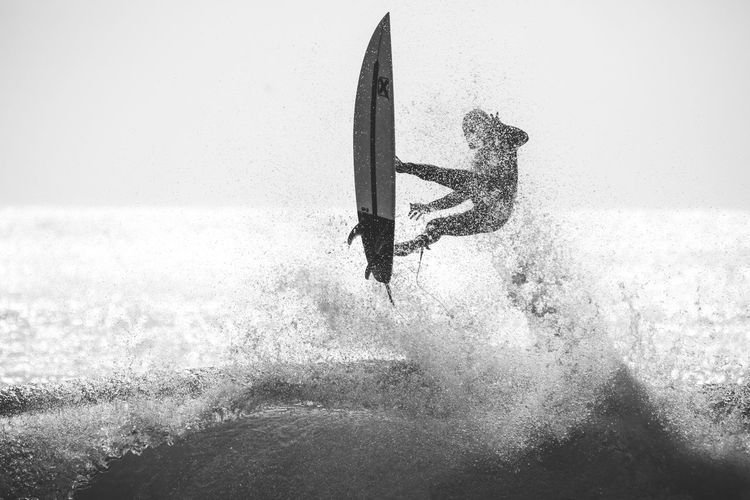 action Algarve Black & White Portugal Adventure Beauty In Nature Blackandwhite Day Extreme Sports Horizon Over Water Motion Nature Ocean One Person Outdoors Real People Sea Skill  Sky Sport Surfing Water Wave Shades Of Winter An Eye For Travel Go Higher