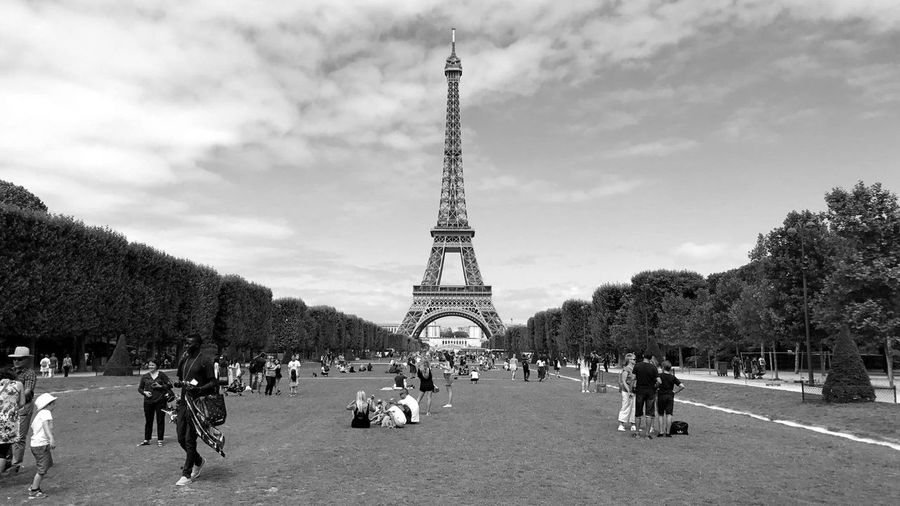 Paris.3.0. Large Group Of People Travel Destinations Tourism Architecture Tower Real People Built Structure Tree History Travel Sky Outdoors People Women Day Men City