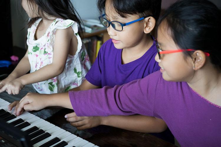 Cute kids playing piano