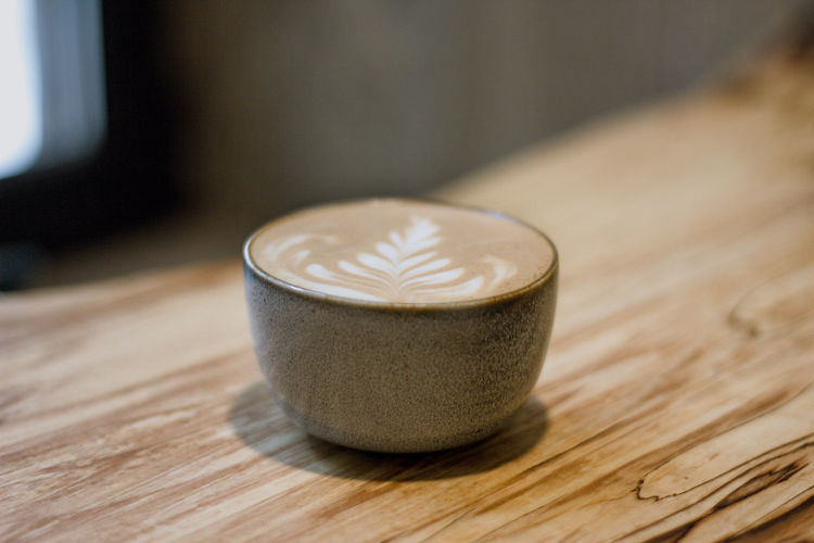 Drink Coffee - Drink Coffee Wood - Material Food And Drink Refreshment Cup Table Indoors  Mug Coffee Cup Hot Drink Close-up No People Still Life Latte Froth Art Frothy Drink Freshness Focus On Foreground Non-alcoholic Beverage Wood Grain Coffee Coffee Time