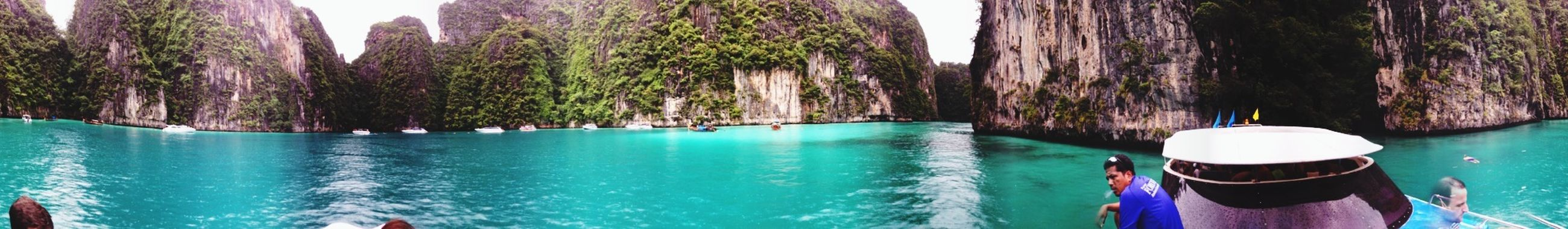 water, blue, sea, tree, tranquility, nature, beauty in nature, turquoise colored, scenics, tranquil scene, mountain, waterfront, day, leisure activity, vacations, swimming pool, idyllic, nautical vessel, outdoors