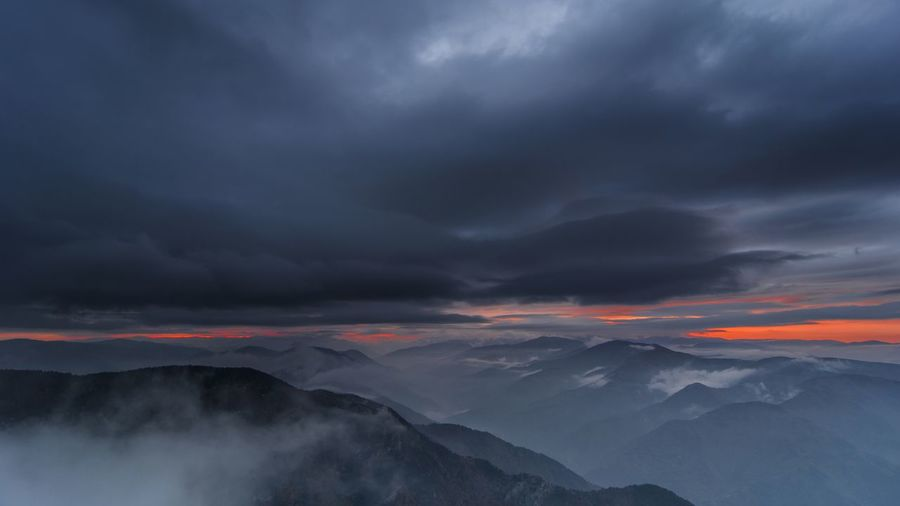 Dramatic mountain sunset with stormy clouds Clouds Sun Sunset Nature Sky Landscape Fog Storm Mist Outdoors Mountain Dramatic Sky Overcast Beauty In Nature Storm Cloud No People Idyllic Mountain Range Non-urban Scene Power In Nature Cloud - Sky Scenics - Nature Tranquil Scene Tranquility Environment Mountain Peak Ominous