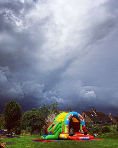 Cloudburst Showcase June Storm Storm Cloud Stormy Weather Rain Rainy Day Bad Weather Neon Colours Fete Fair Inflatable  Bouncy Castle Play School Fun Day