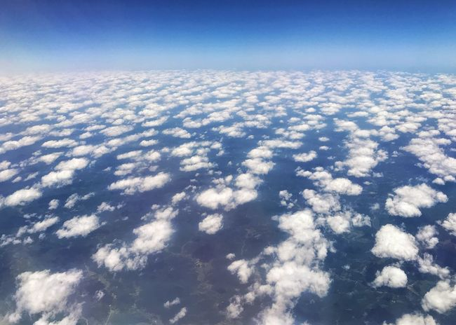 Clouds over landscape showing earths curvature. Curvature Of The Earth Cotton Balls Clouds Horizontal Sky Nature Beauty In Nature Scenics - Nature Cloud - Sky No People Tranquility Blue Tranquil Scene Aerial View Environment