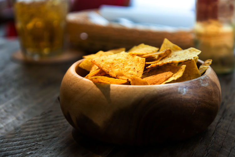 Close-Up Of Nacho Chips In Bowl On Table