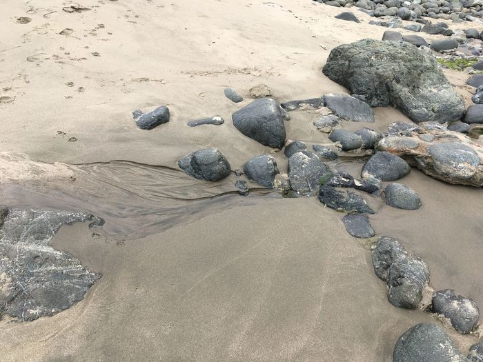 Water finds its way Baker Beach San Francisco California Land Sand Rock Solid Beach Nature Water Rock - Object Outdoors Day No People Sea Tranquility Stone - Object Beauty In Nature Marine