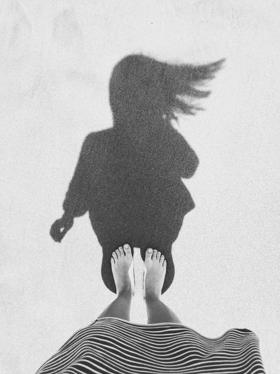 Hair in the wind Barefoot Black And White Photography Blackandwhite Day Female Foot From Above  Hair In The Wind Human Body Part IPhoneography Iphonephotography Minimal Outdoors Portrait Sand Shadow Silhouette Summer Toes Vacation Wind Woman Portrait Breathing Space
