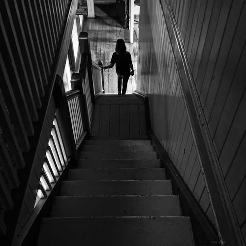 Rear View Of Woman On Stairway