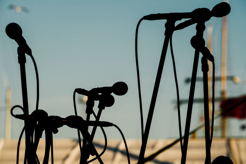 Silhouette Microphones Against Sky