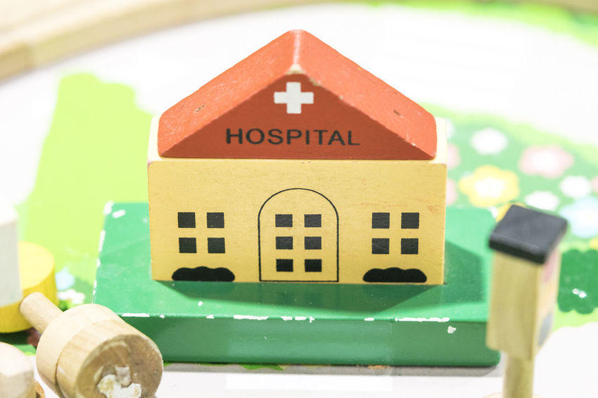 Hospital Wooden Toy Set Play set Educational toys for preschool indoor playground (selective focus) Hospital Close-up Text Communication No People Western Script Focus On Foreground Toy Green Color Architecture Indoors  Capital Letter Multi Colored Sign Still Life Art And Craft Red Built Structure Creativity Wooden Toy Wooden Toy Block