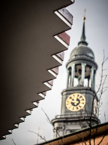 Saw teeth in front of St. Michaels church steeple Hamburg Church Churchtower St. Michael Church Steeple Michel Steeple Church Spire Saw Saw Tooth Saw Teeth Saw Band Saw Blade Blurred Vague Unclear Diffuse Fuzzy