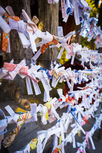 Close-up of various notes tied to railings
