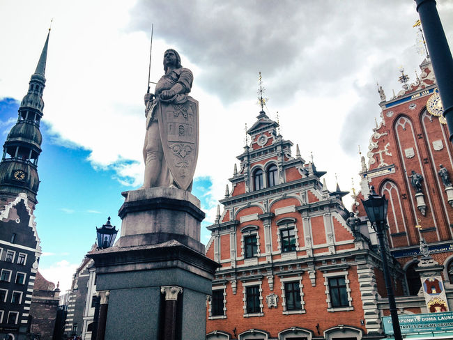 Saint Roland statue, town square, Riga, Latvia Architecture Building Exterior Built Structure Famous Place Fish-eye Lens Historic History Human Representation International Landmark Latvia Low Angle View Medieval Outdoors Perspective Place Of Worship Religion Riga Roland Sculpture Spirituality Square Statue