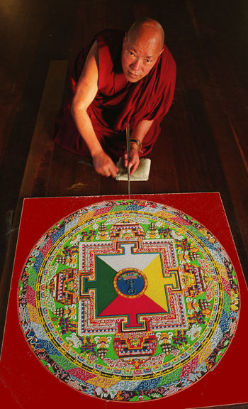 Gyuto Monks of Tibet Gyuto Monks Of Tibet Tibetan Buddhism Buddhism Indoors  Monks Religion Sand Drawing Sitting Tibet Traditional Clothing