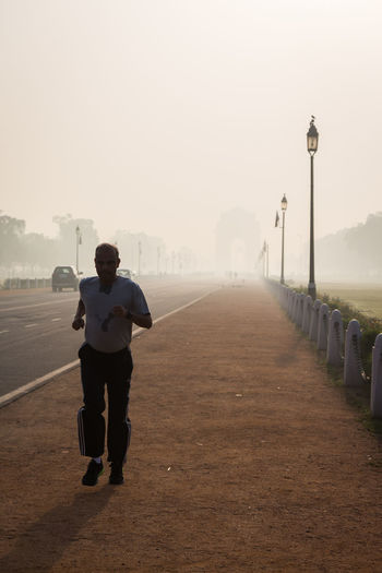 man Jogging in Rajpath, Delhi, India Active Lifestyle  Delhi Delhidiaries DelhiGram Indianstories Indiapictures Jogging Outdoor Pictures Rajpath Street Photography