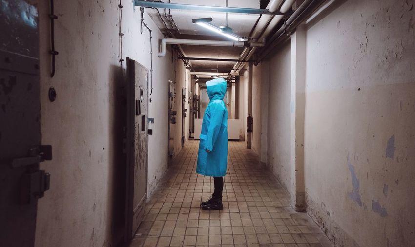 Person standing in prison corridor