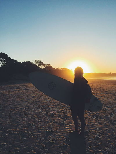 Surf Beach Beauty In Nature Full Length Leisure Activity Lifestyles Nature One Person Outdoors Real People Sea Silhouette Sky Standing Sun Sunset Surfing Tranquility Water