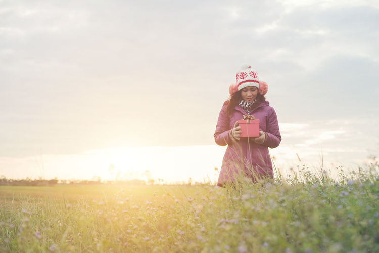 Child Childhood Field Front View Girls Grass Innocence Land Landscape Nature Offspring One Person Outdoors Plant Sky Smiling Standing Sunlight Sunset Three Quarter Length