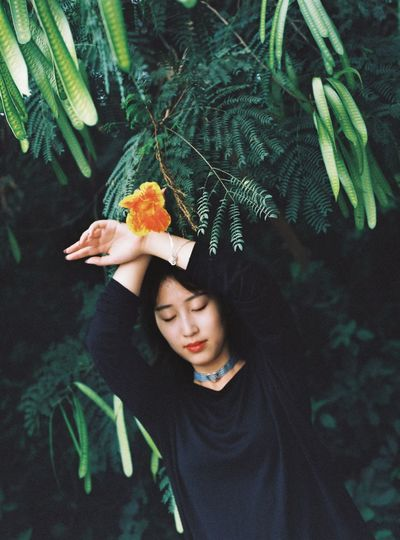 Woman holding leaves of plant