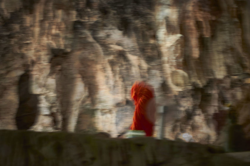 Abstract images of a monk in a cave Blur Blurred Motion Buddha Buddism Cave In Motion In Motion, Monk  Orange Red Selective Focus Selective Focusing Temple Tranquility Underground