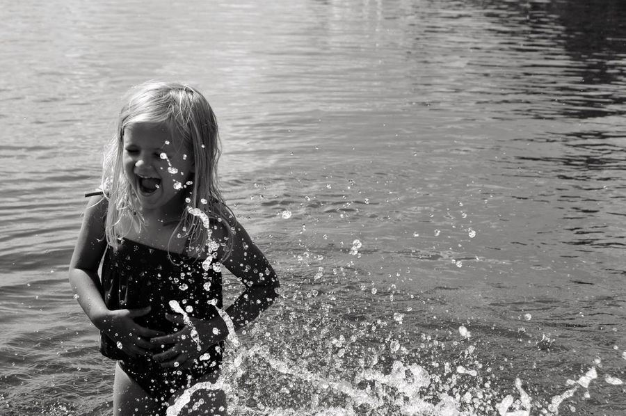 Summer in the sea Sea Summer Portrait Blackandwhite Black And White Girl Beauty In Nature Water Child Childhood Real People Lifestyles One Person Nature Splashing Girls Motion Sunlight Enjoyment Outdoors Wet Hair Innocence Waterfront Day Leisure Activity Front View The Great Outdoors - 2018 EyeEm Awards The Portraitist - 2018 EyeEm Awards