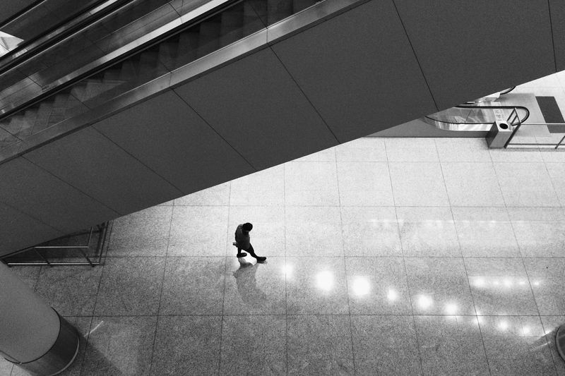 High Angle View Of Person Walking On Subway Platform