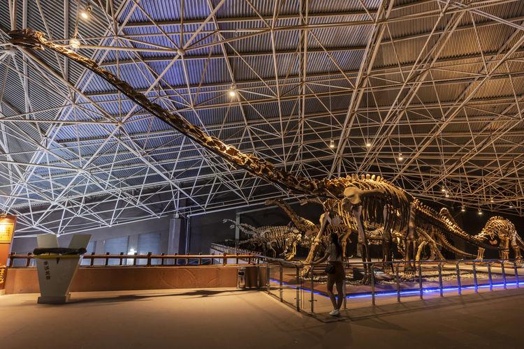 Low angle view of illuminated lighting equipment at museum