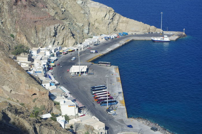 Griechenland Griechische Inseln Hafen Santorini Greece Santorini Island Santorini, Greece Aerial View Architecture Building Exterior Built Structure Day Greece High Angle View Mountain Nature Nautical Vessel No People Outdoors Port Santorini Sea Sky Transportation Water