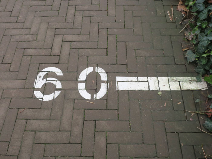 High angle view of text on footpath