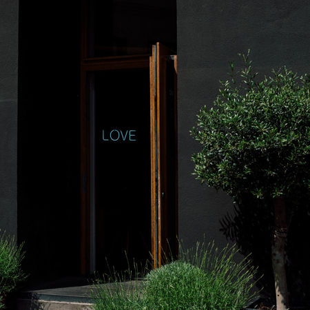 You never know what you'll find behind a door until you open it. Love Signs Wall Architecture Building Building Exterior Door Entrance Grey House No People Open Outdoors Streetphotography Tree