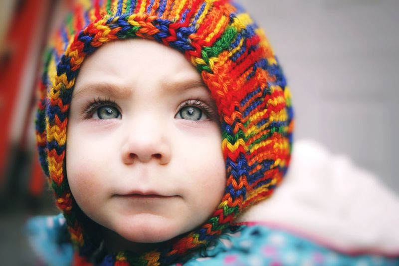 Close-up portrait of baby girl in warm clothes