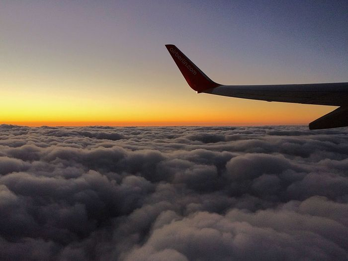Cloudscape seen through airplane wing