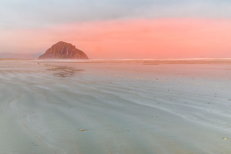 Dreamy morning on the beach of morro bay with the morro rock, california