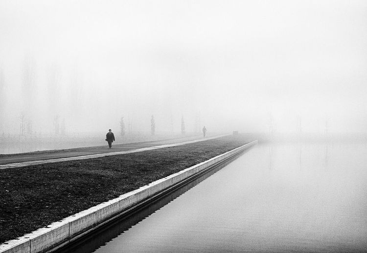 Blankness... Fog Weather One Person Foggy Tranquility EyeEm Best Shots Blackandwhite Street Photography Tranquil Scene Day Mist Water Outdoors Alone Remote Calm Sky Nature One Woman Only Scenics Non-urban Scene Monochrome Photography