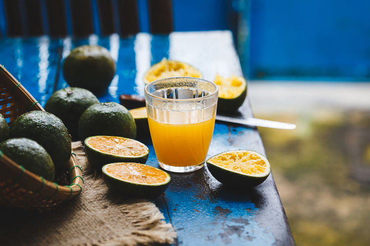 Oranges on the old wood ASIA Bamboo Basket Blue Burlap Diet Food Food Art Fresh Freshness Healthy Eating Nature Old Wood Orange Orange Juice  SLICE Table Trai Cam Tropical Vietnam Vietnamese Fruit Wet