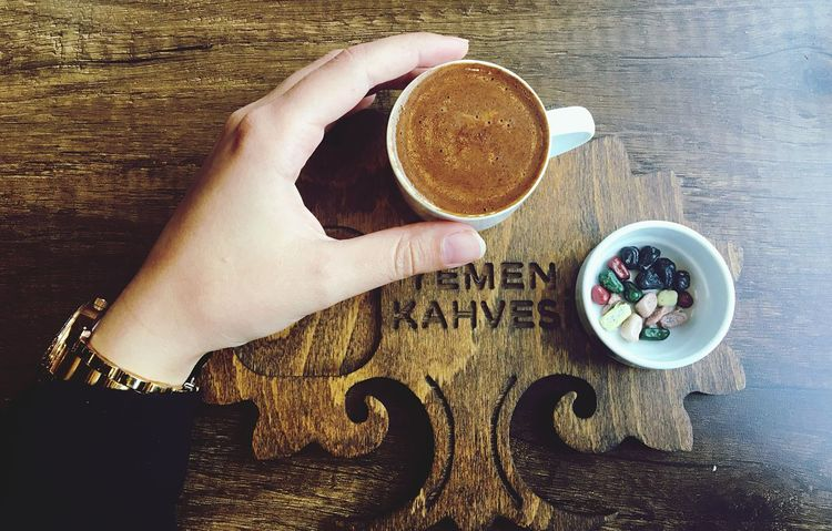 Coffee Cup Coffee - Drink Drink Table Human Hand Food And Drink Human Body Part High Angle View One Person Refreshment Indoors  Wood - Material Holding Directly Above Breakfast Real People Freshness Food Lifestyles Close-up Turkishcoffee Handsup  Hello World