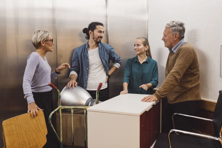Group of people standing on table