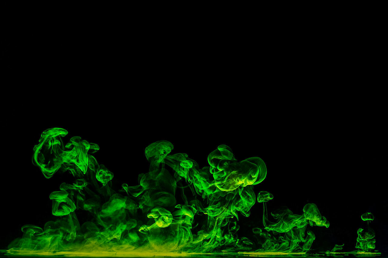 green color, smoke - physical structure, black background, studio shot, copy space, abstract, motion, multi colored, close-up, no people, fragility