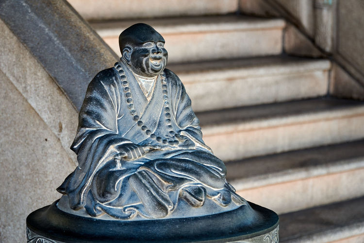 Buddha statue on staircase
