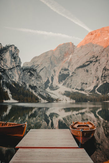 Beauty In Nature Day Formation Idyllic Lake Mode Of Transportation Moored Mountain Mountain Range Nature Nautical Vessel No People Non-urban Scene Outdoors Reflection Rowboat Scenics - Nature Sky Tranquil Scene Tranquility Transportation Water
