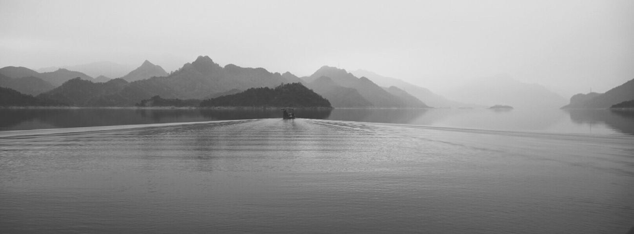 Mountain The Week On Eyem Water Scenics Nature Beauty In Nature Real People Tranquility Lake Day Reflection Tranquil Scene Outdoors One Person Non-urban Scene Waterfront Clear Sky Leisure Activity Vacations Sky Landscape Blackandwhite Film Travel EyeEmNewHere