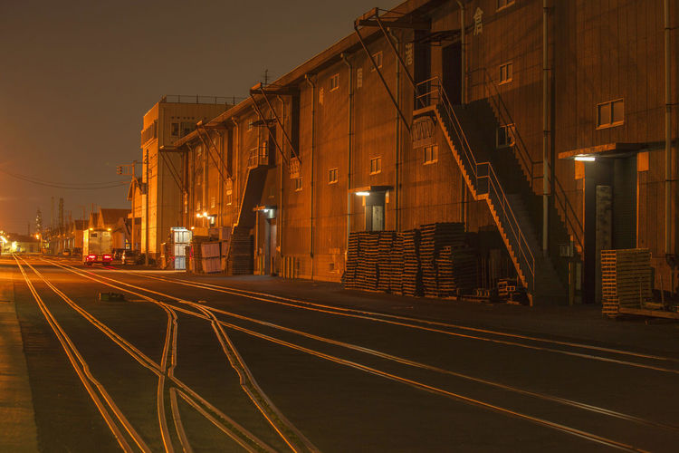 factory in japan Architecture Building Building Exterior Built Structure City Direction Illuminated Lighting Equipment Marking Night No People Rail Transportation Road Road Marking Sky Street Street Light The Way Forward Track Transportation