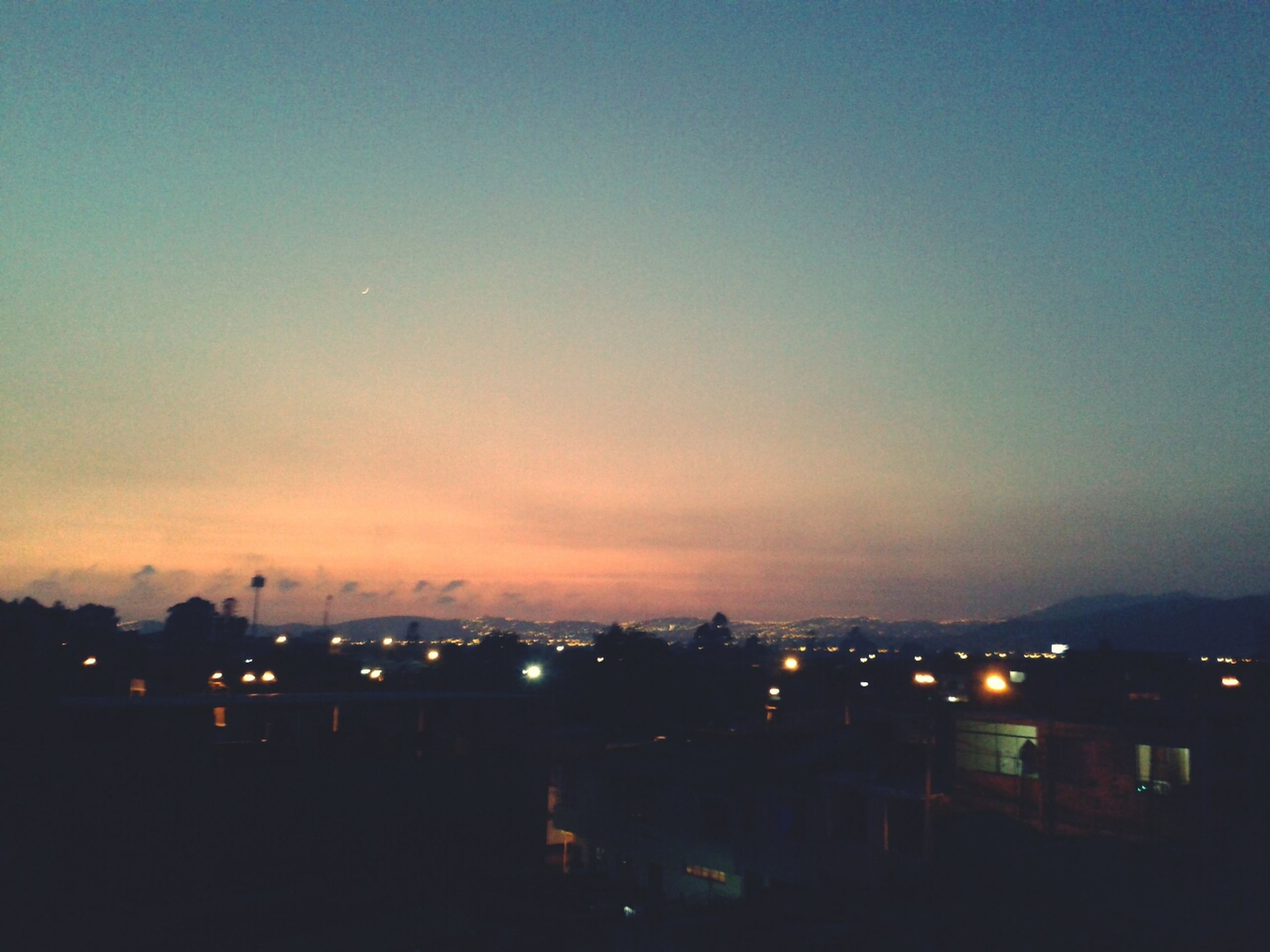illuminated, building exterior, night, architecture, built structure, silhouette, sky, city, copy space, dusk, sunset, cityscape, residential structure, dark, house, residential building, outdoors, scenics, residential district, moon