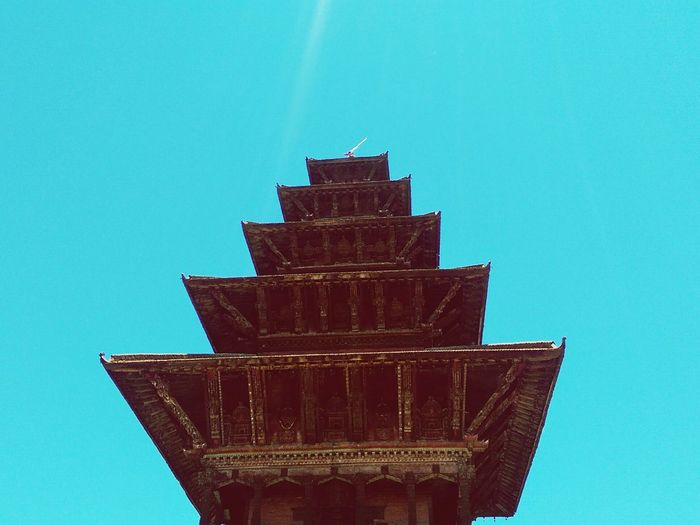 Up Close Street Photography Nepal Kathmandu Low Angle View Blue Sky Temple Pagoda Sky Porn Daylight Ancient Architecture Close-up Eyem Architecture Eyem Best Shots Eyemphotography Layers Building Exterior Man Made Structure Taking Photos Edited Turquoise